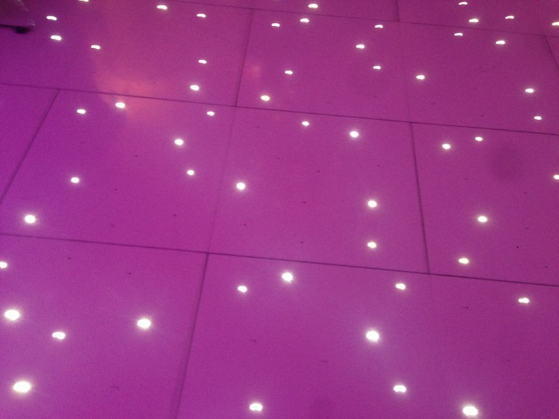 Uplights reflecting in our White Starlit Dancefloor at event in London